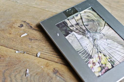 Wedding picture frame broken on floor