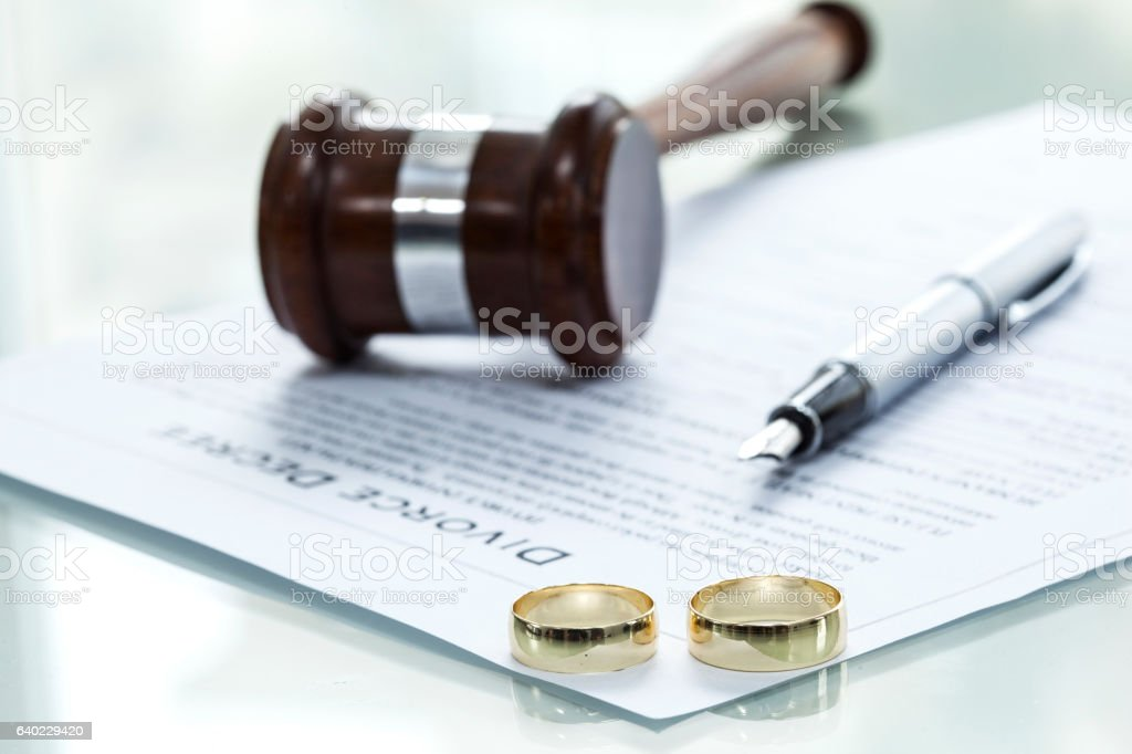 Divorce decree form with ring stock photo