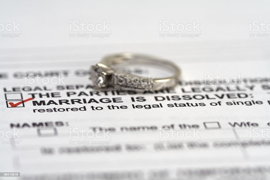 Divorce Papers and Woman's Ring royalty-free stock photo
