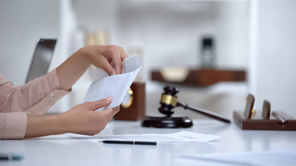 Divorced woman holding envelope with alimony, savings for single mom, allowance stock photo