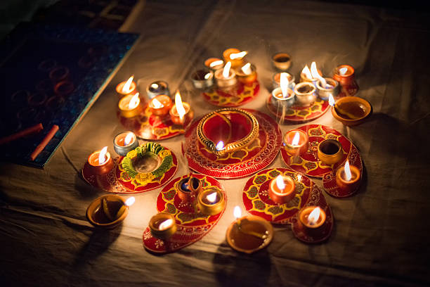 diwali candles and oil lamps at night - diwali stock pictures, royalty-free photos & images