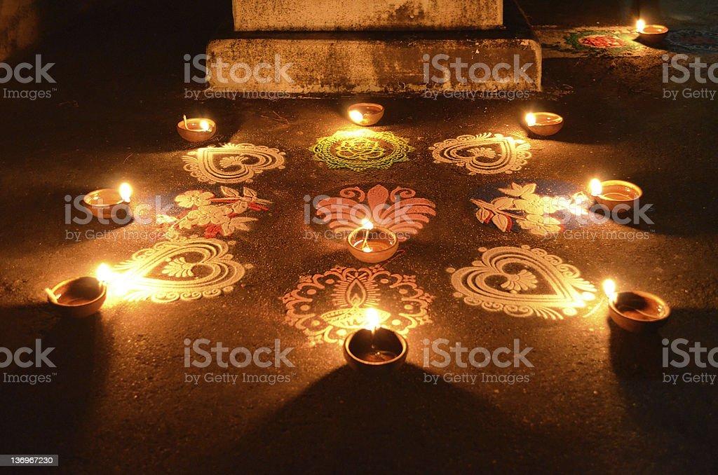 Diwali candles and rangoli stock photo