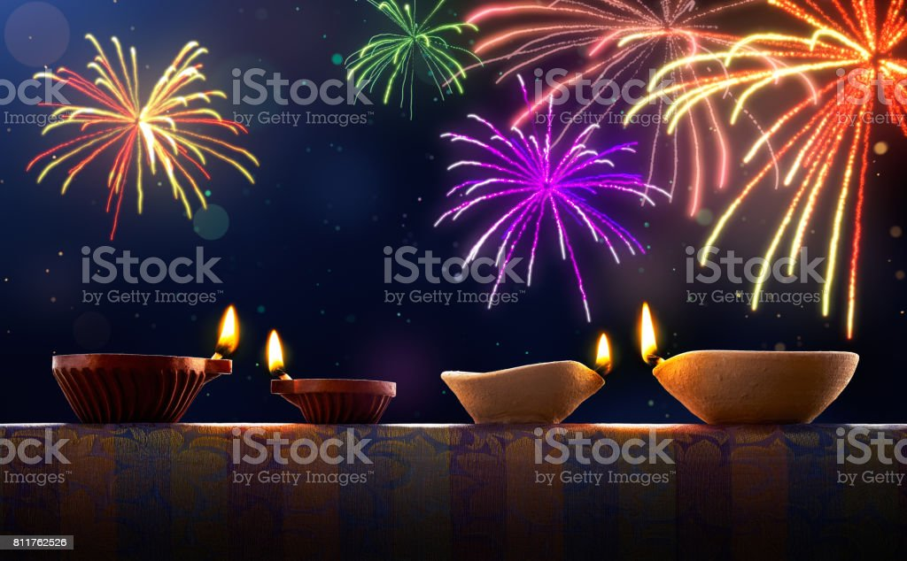 Diwali celebration with diya lamps and fireworks stock photo