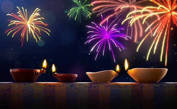 diwali celebration with diya lamps and fireworks - diwali stock pictures, royalty-free photos & images