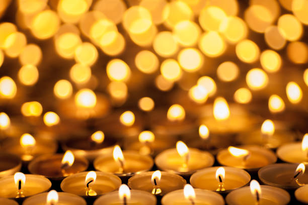 Diwali Festival of Lights. Beautiful candlelight. Selective focus on foreground of many burning tealight candles. stock photo