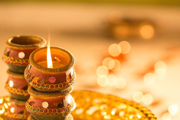 diwali lights and diyas - diwali stock pictures, royalty-free photos & images