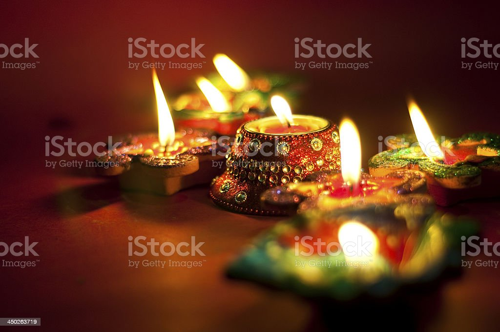 Diwali oil lamps lit up at night stock photo