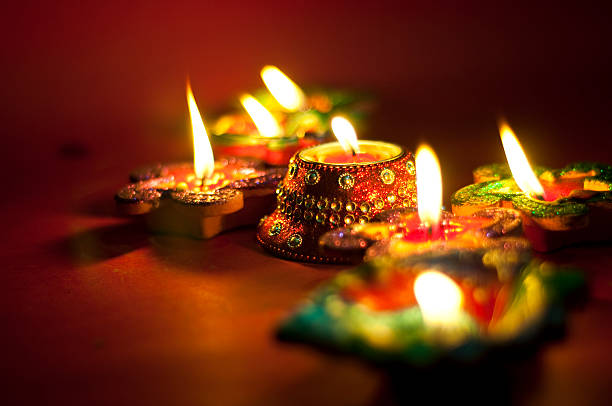 diwali oil lamps lit up at night - diwali stock pictures, royalty-free photos & images