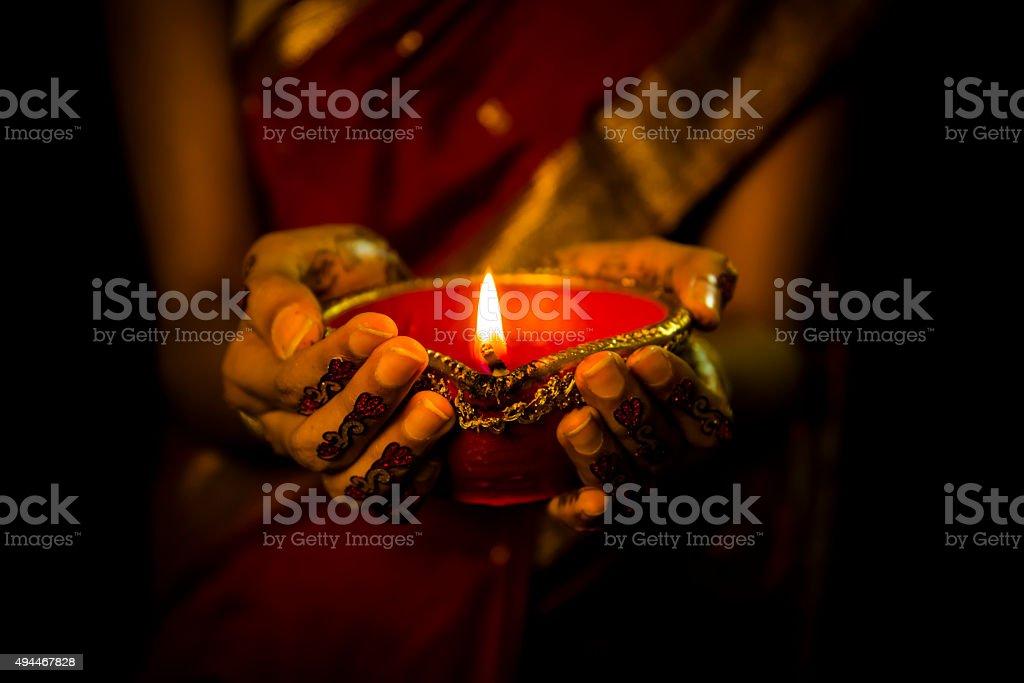 diwali close up shot of femele hand holding diva on diwali festival with tatto on hand shot with full frame dslr nikon d750 2015 Stock Photo