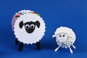 Diy Eid al adha lamb sheep cotton pads, cotton buds, swabs on blue background. Gift idea, decor Eid al adha. Step by step. Top view. Process kid children craft. Workshop.