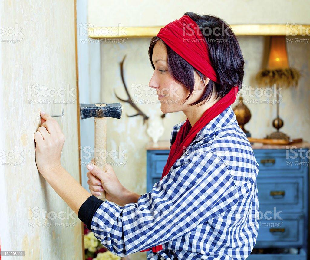 Diy fashion woman with nail and hammer royalty-free stock photo