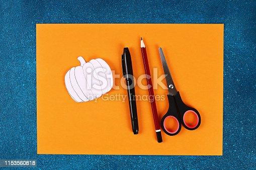 istock Diy Halloween paper bracelet pumpkin on black background. Gift idea, decor Halloween 1153560818