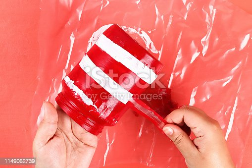 istock Diy vase 4th of July glass jar, acrylic paint, glitter, tape color American flag red blue white 1149062739