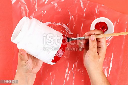 istock Diy vase 4th of July glass jar, acrylic paint, glitter, tape color American flag red blue white 1149062741