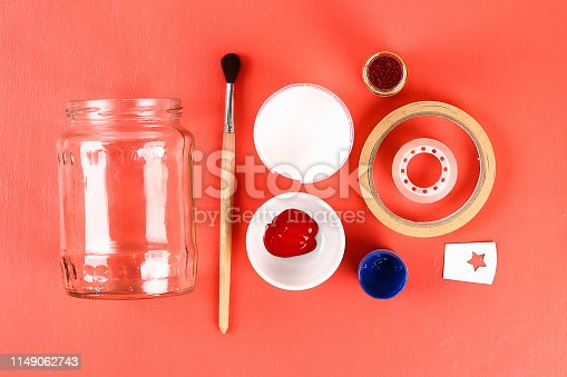 istock Diy vase 4th of July glass jar, acrylic paint, glitter, tape color American flag red blue white 1149062743