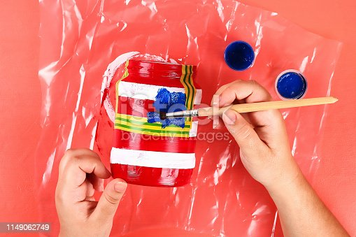 istock Diy vase 4th of July glass jar, acrylic paint, glitter, tape color American flag red blue white 1149062749