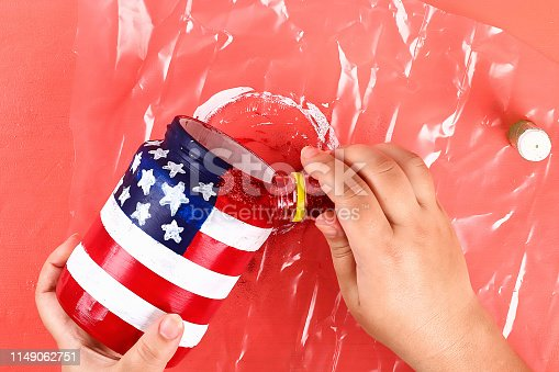 istock Diy vase 4th of July glass jar, acrylic paint, glitter, tape color American flag red blue white 1149062751