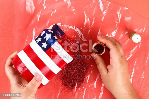 istock Diy vase 4th of July glass jar, acrylic paint, glitter, tape color American flag red blue white 1149062756