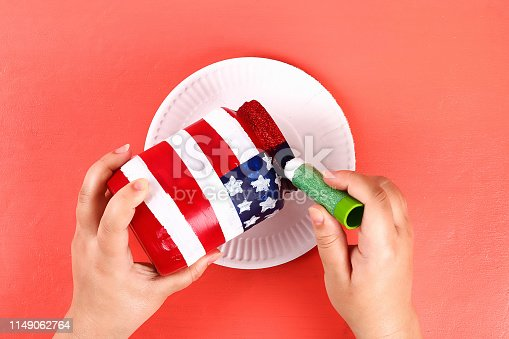 istock Diy vase 4th of July glass jar, acrylic paint, glitter, tape color American flag red blue white 1149062764