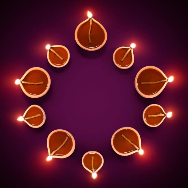 Diya lamps in a circle formation stock photo