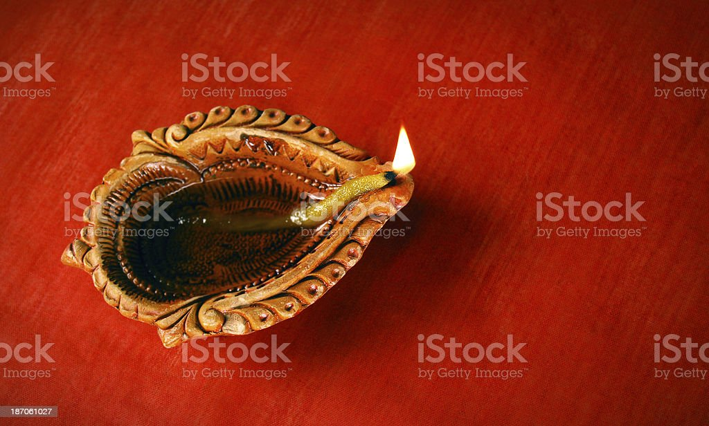 Diya on grungy surface - Concept of celebration royalty-free stock photo