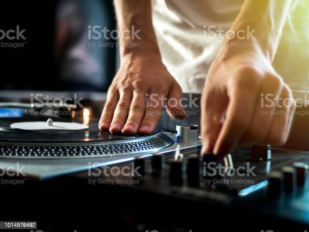 Dj hands on professional music equipment deck vinyl record turntable picture id1014576492?b=1&k=6&m=1014576492&s=612x612&h=nrhroyhvdxguvojqx850jpjclmwaj9kbq1lmwvf3x s=