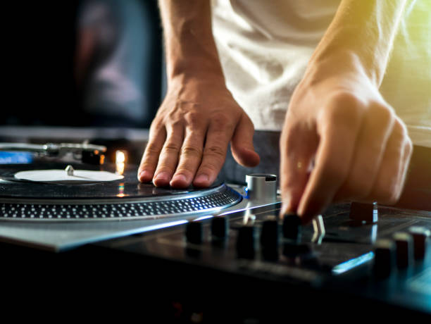 dj hands on professional music equipment deck vinyl record turntable and timecode dj hands on professional music equipment deck vinyl record turntable and timecode dj stock pictures, royalty-free photos & images