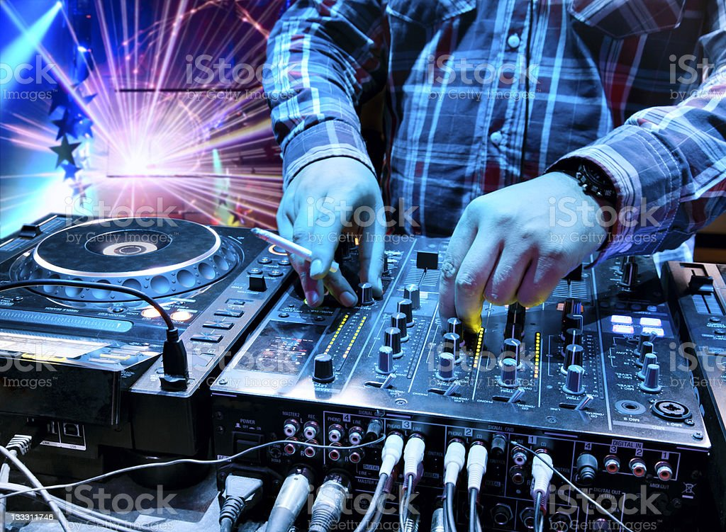 Dj in the nightclub at party stock photo