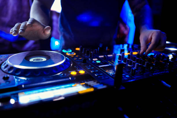 Dj mixes the track in the nightclub at party Dj mixes the track in the nightclub at party dj stock pictures, royalty-free photos & images