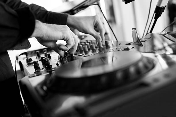 Dj mixes the track in the nightclub at party stock photo