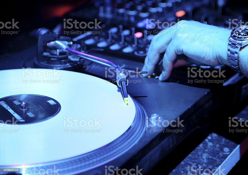 Dj mixes the track royalty-free stock photo