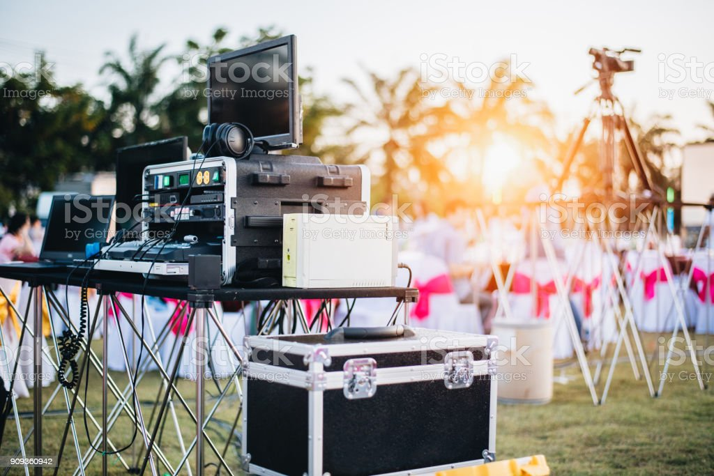 Dj mixing equalizer at outdoor in music party festival with party dinner table. Entertainment and Event organizer concept. Concert and Musical theme stock photo