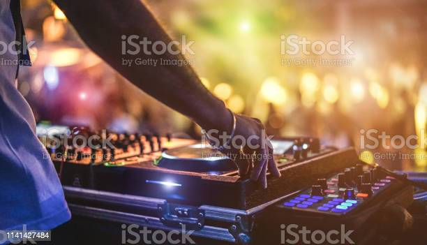 Dj mixing outdoor at beach party festival with crowd of people in picture id1141427484?b=1&k=6&m=1141427484&s=612x612&h=lcq6wa9pjekonhgdxeeurca deqeardb exn16fprvs=