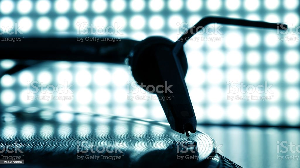 Dj needle stylus on record, blur light background stock photo