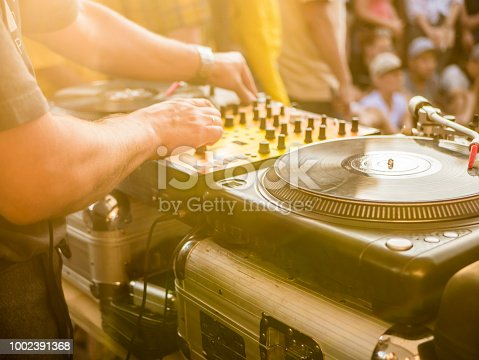 istock dj play music summer party 1002391368