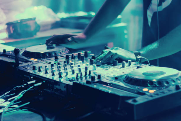 dj playing music at party dj playing music at party electronic music stock pictures, royalty-free photos & images