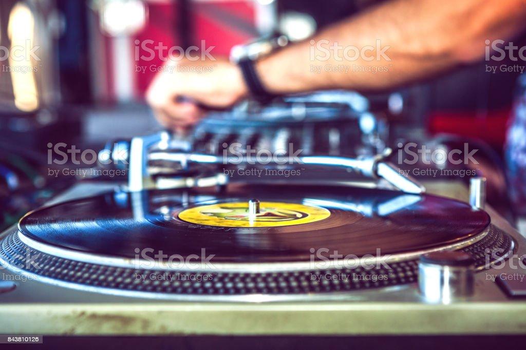 Dj playing music vinyl disc stock photo