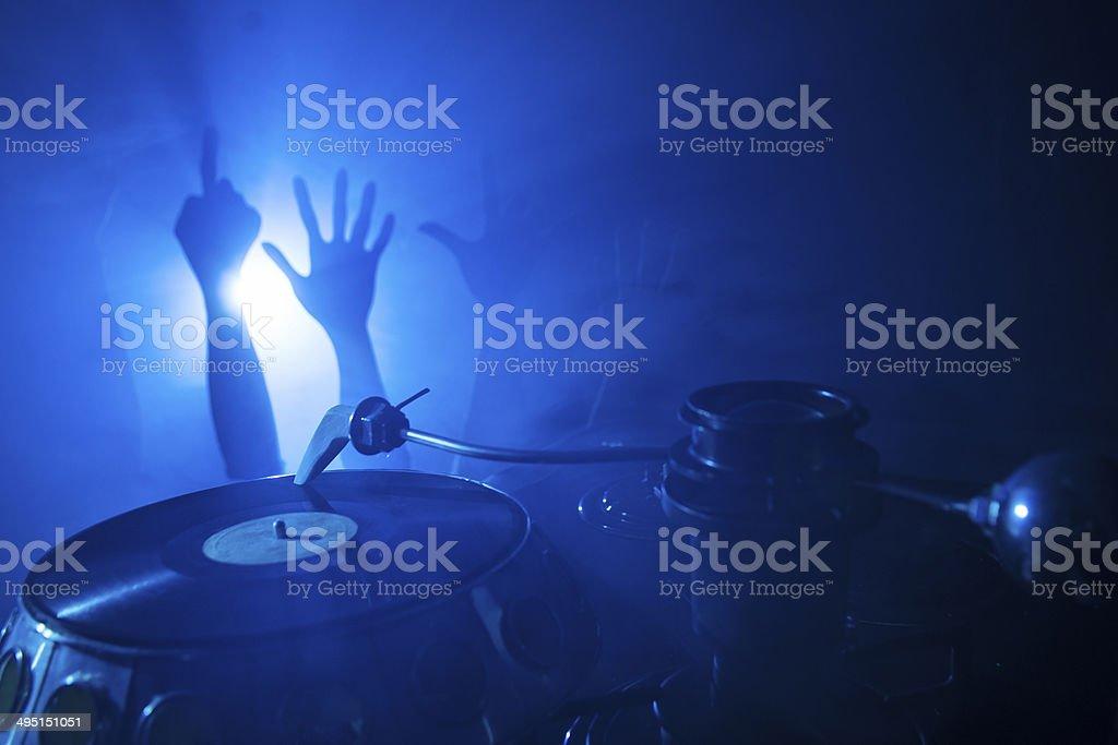 Dj playing on vinyl stock photo
