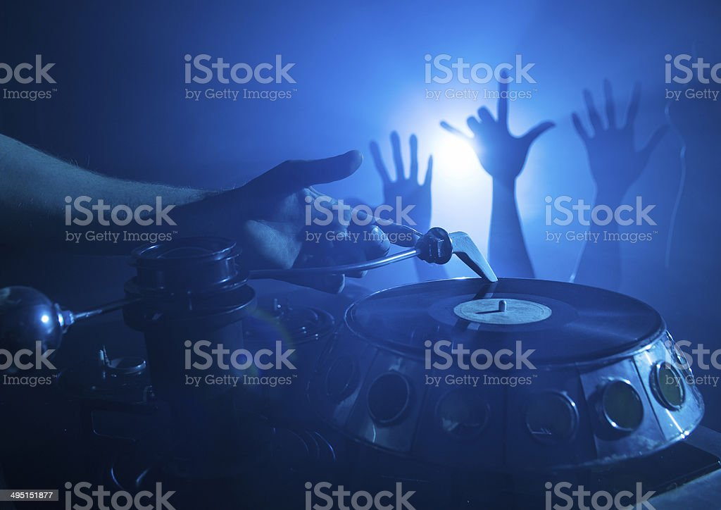 Dj playing on vinyl royalty-free stock photo