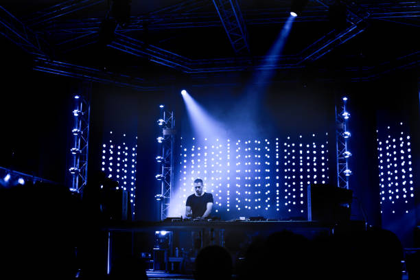 Dj playing techno music on the stage stock photo