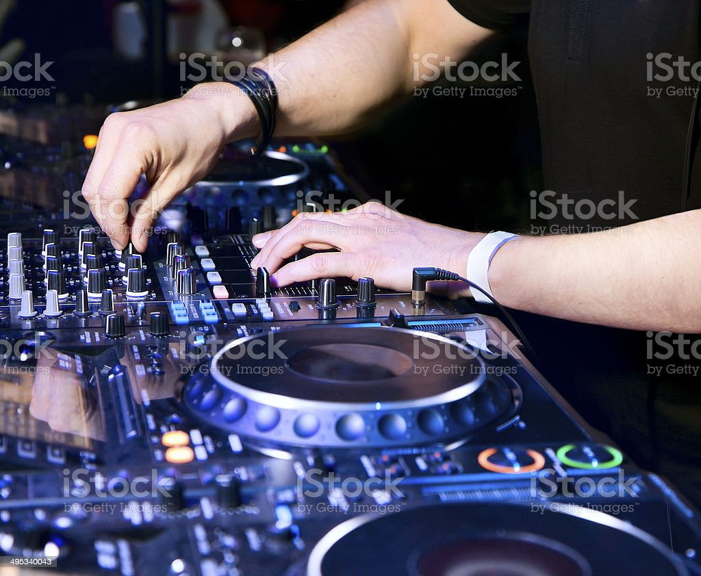 Dj playing the track royalty-free stock photo