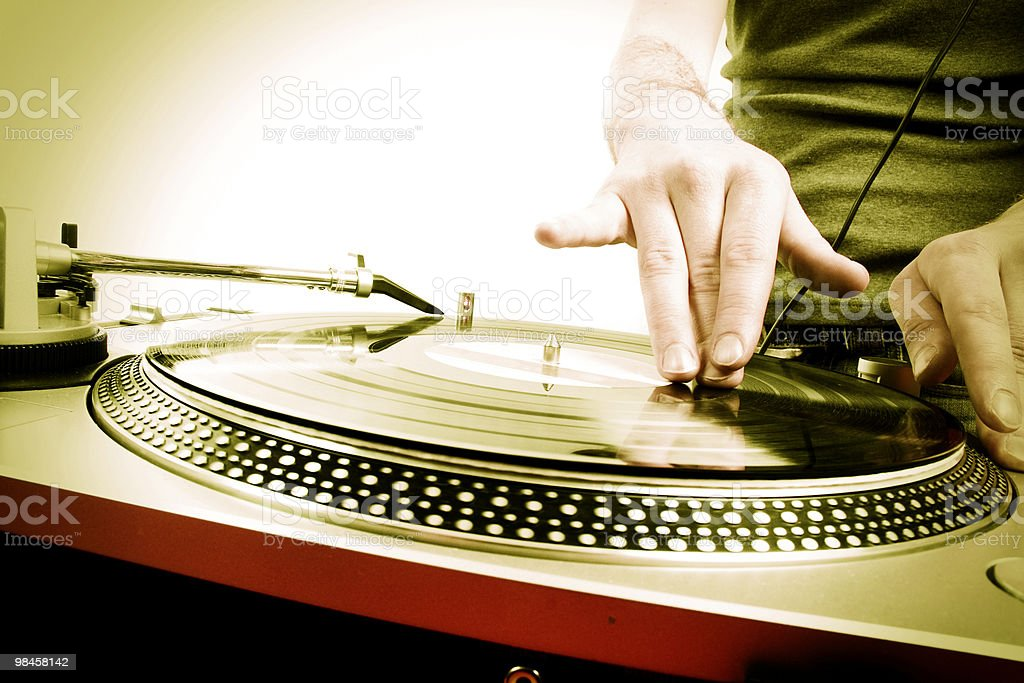 A dj spinning a playing record royalty-free stock photo