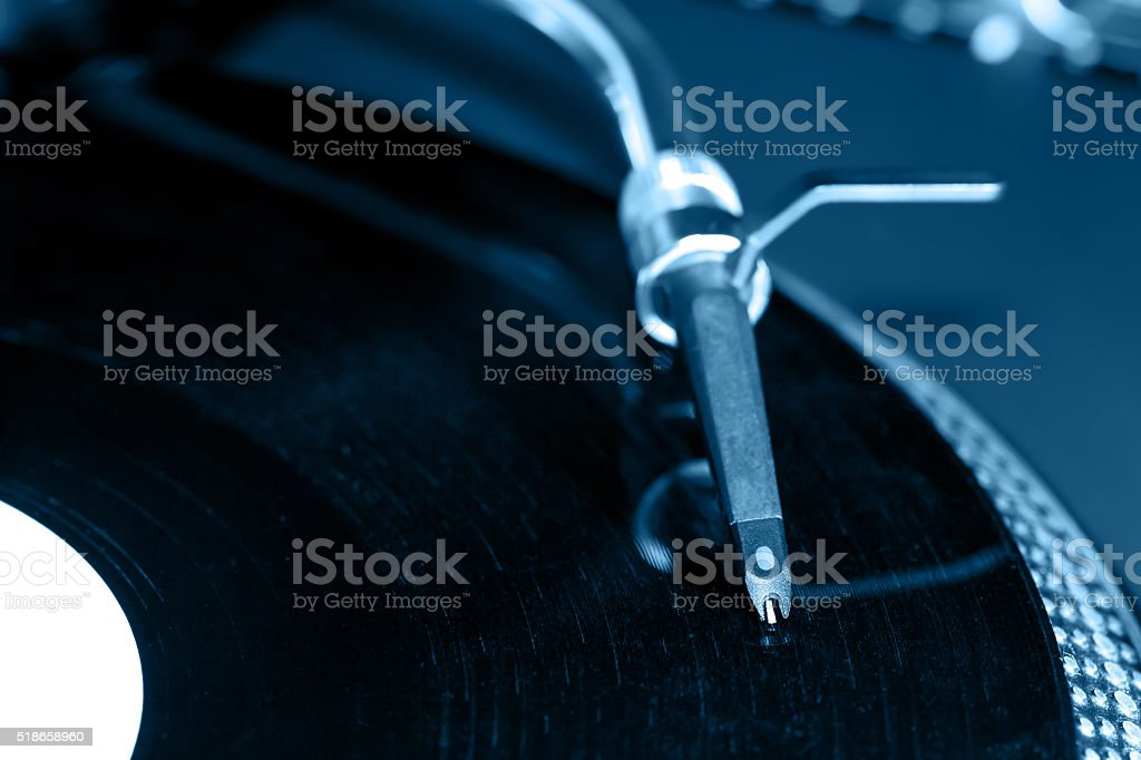 Dj  stylus on vinyl record stock photo