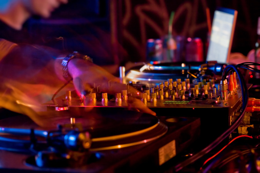 a close-up of dj hands at workplease see other related images: