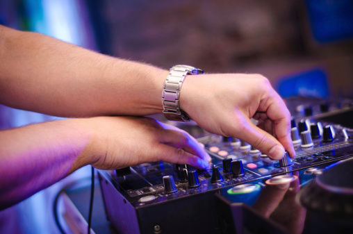 a close-up of dj hands at work. Photo shouted on party.