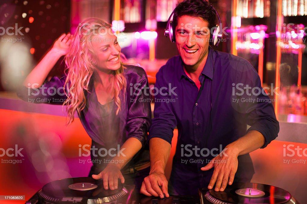 DJs in nightclub stock photo