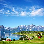 Lyngen fjord and Lyngen Alps on backgrond in Troms county, Norway. Composite photo