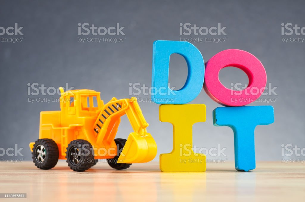 Do and don\'t concept, colorful alphabet word DO IT on wooden desk...