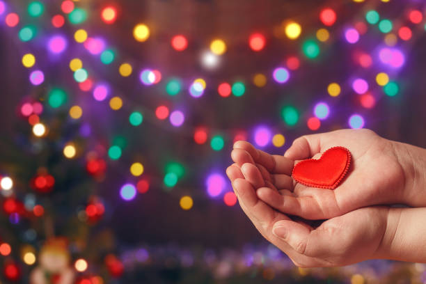 do good things. create well deeds. charity and miracle. christmas and new year mood. festive background. to make people happy. xmas miracle. charitable foundation. helping hand. give love. holiday. - organ donation stock pictures, royalty-free photos & images