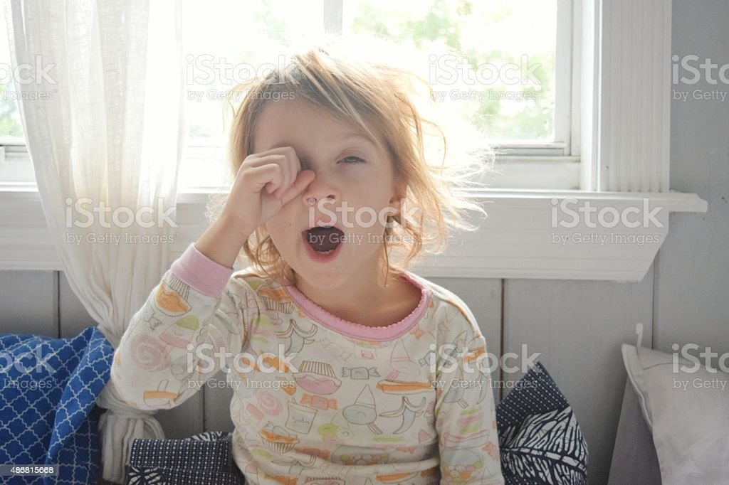 Do I have to? Little girl doesn't look quite ready for the day 2015 Stock Photo